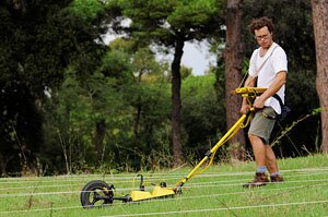 Executing a GPR survey (photograph by G. Verhoeven)