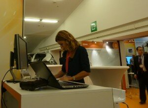Cristina Corsi, coordinator of the Radio-Past Project, at stand 33 of the IC exhibition.